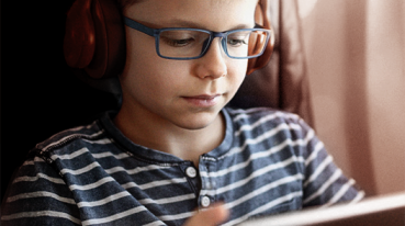 Boy looking at the tablet on the plane
